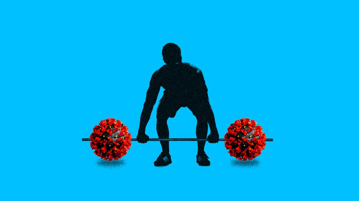A man lifts a dumbbell bar with red coronaviruses where the dumbbells should be