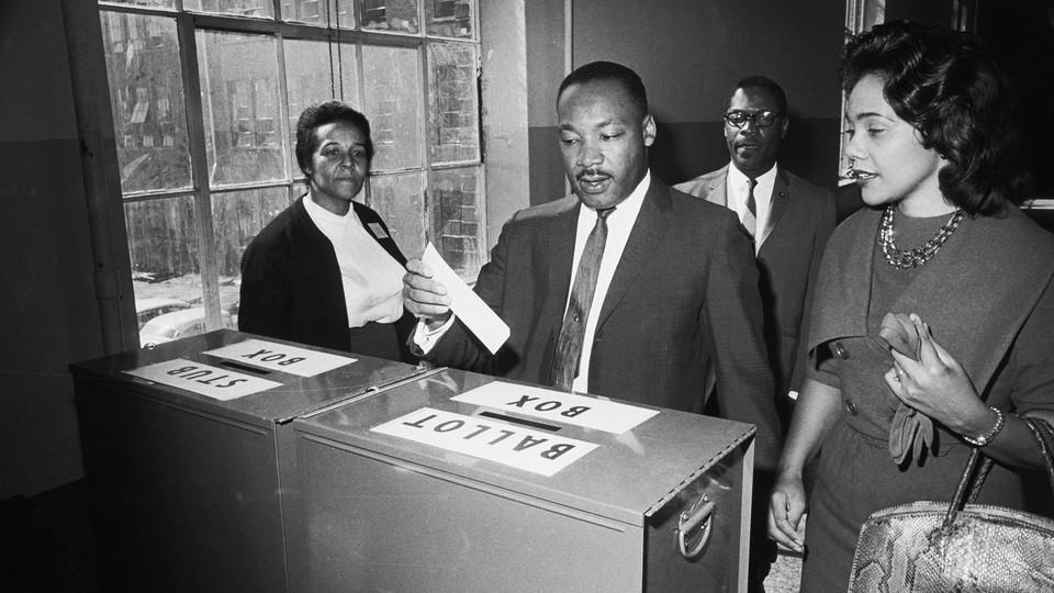 King casts his ballot in Atlanta in 1964