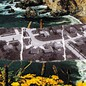 Housing in California over postcard with coastal scene