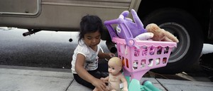 Delmi Ruiz Hernandez, 4, top, plays outside of an RV where her family lives on Thursday, Oct. 5, 2017, in Mountain View, Calif. The Ruiz Hernandez was family was left homeless after the landlord in the apartment they rented hiked their rent beyond what they could afford.