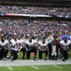 Baltimore Ravens players, including former player Ray Lewis, kneel during the playing of the U.S. national anthem before an NFL football game against the Jacksonville Jaguars at Wembley Stadium in London, Sept. 24.