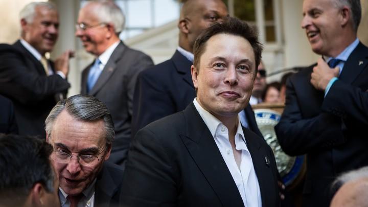 Elon Musk makes a face.