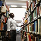A man in a library is pictured.