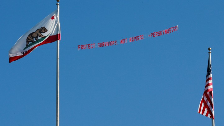 A plane flies over the Stanford stadium trailing a banner calling for the dismissal of the judge in the Stanford rape case prior to the Stanford University commencement ceremony in June.