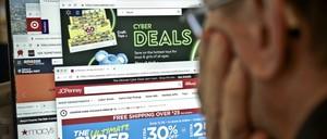 photo: an online shopper staring at a computer screen