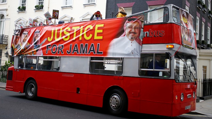 A double-decker bus in London bears a banner calling for justice following the death of Jamal Khashoggi.