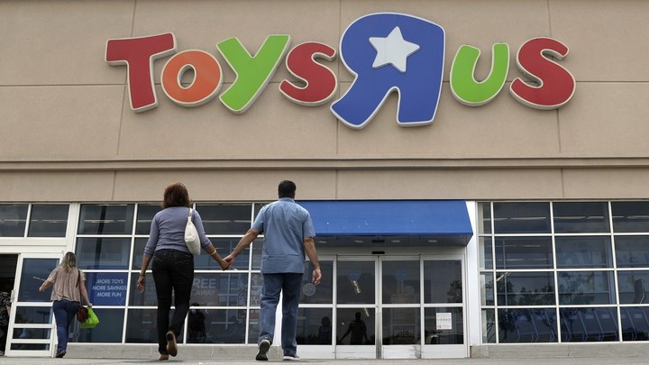 "Two shoppers walk into a Toys ""R"" Us store"