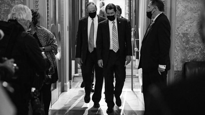 Senators exiting the chamber