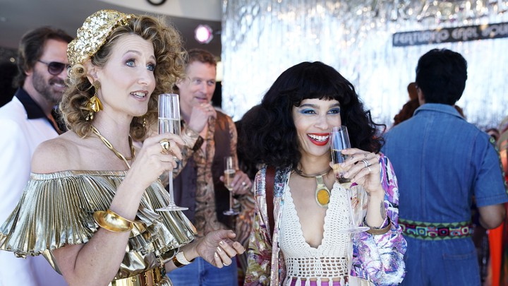 Renata (Laura Dern) and Bonnie (Zoë Kravitz) at a party for Amabella in 'She Knows'