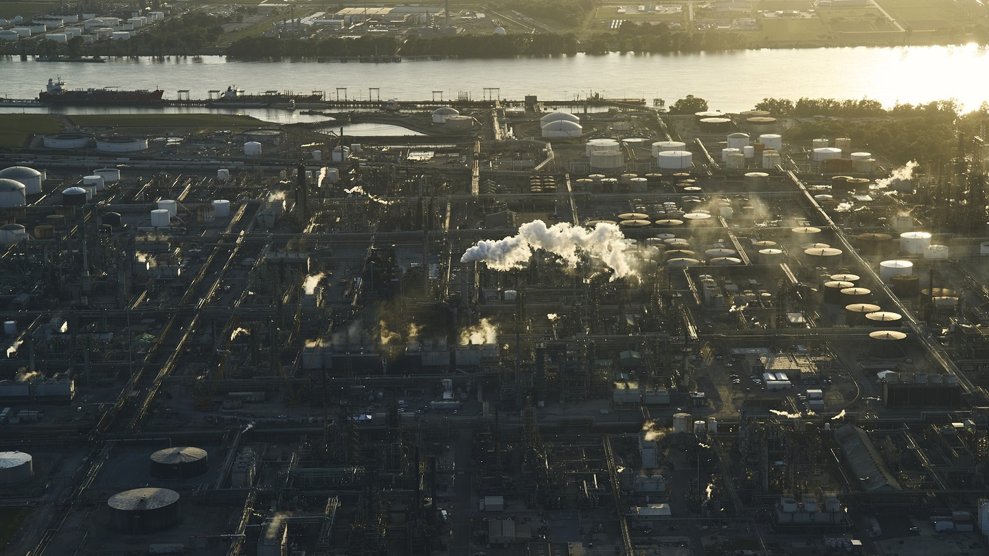 An overhead shot of chemical plants along a river