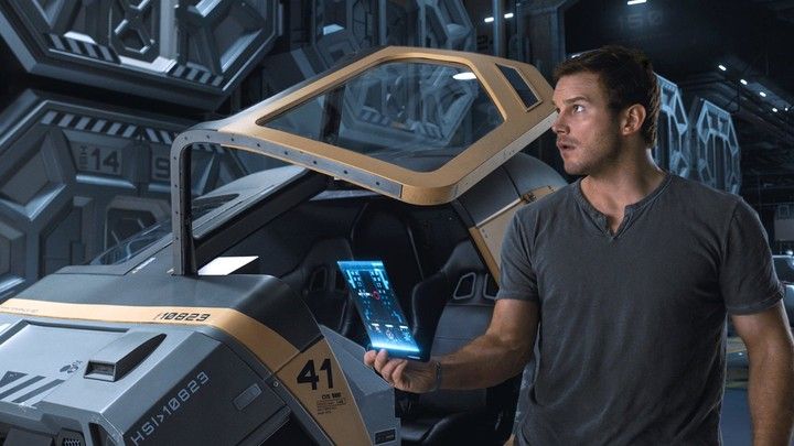 Chris Pratt stands in front of a hibernation pod in the movie Passengers.