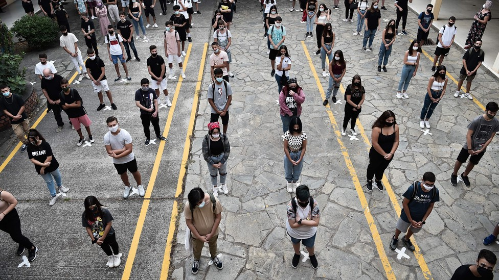 High-school students socially distance in Greece.