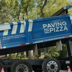 """A road repair truck for Domino's """"Paving for Pizza"""" campaign."""