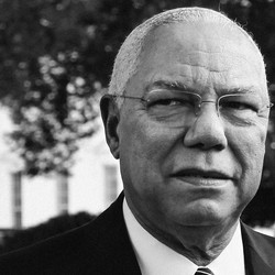 Colin Powell looks past the camera outside the White House.
