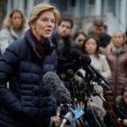 Sen. Elizabeth Warren speaks to reporters outside her home in Cambridge, Massachusetts, after she announced that she has formed an exploratory committee to consider running for president in 2020.