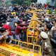 Police and protesters scuffle outside a university in New Delhi.