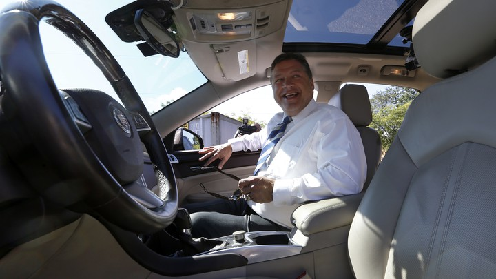 U.S. Rep. Bill Shuster, the chairman of the House Transportation and Infrastructure Committee, smiles as he steps into the passenger seat of a a self-driving car in Pennsylvania, in 2013.