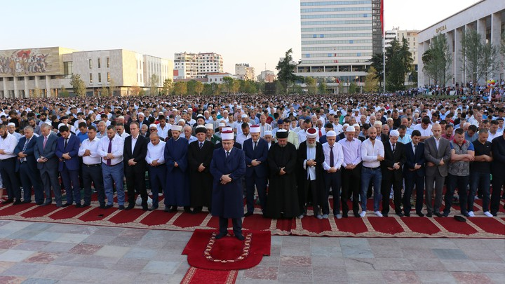 Men gather in Skanderbeg Square in Tirana, Albania, for the Eid al-Fitr prayer service to mark the end of Ramadan in 2017.