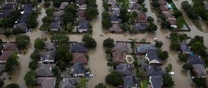 An aerial shot of a flooded neighborhooda