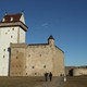 Visitors walk on the grounds of Narva's Hermann Castle, which is separated from Russia's Ivangorod Fortress behind it by the Narva River.