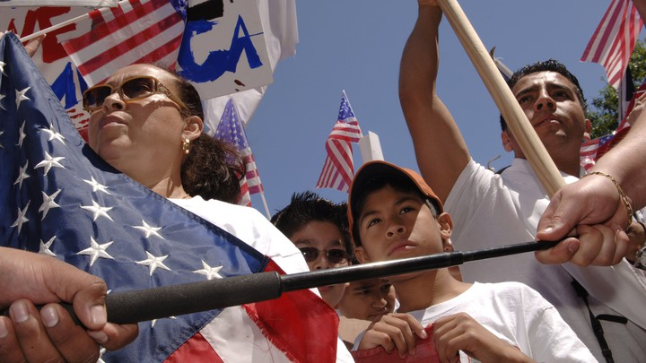 A photo of Latinos demonstrating with American flags