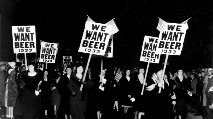 """Women march holding """"We Want Beer"""" signs in an anti-Prohibition parade in 1932."""