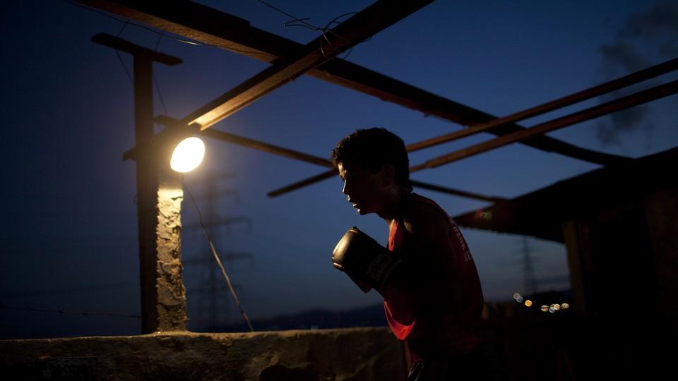 A boy wearing a boxing glove