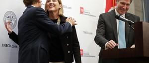 Amazon public policy representative Holly Sullivan hugs Tennessee Governor Bill Haslam.