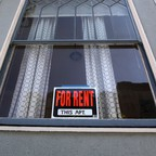 photo: a For Rent sign in a window in San Francisco.