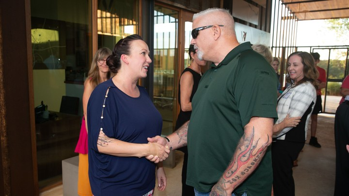 M. J. Hegar, a candidate for Senate in Texas, shakes hand with a voter.