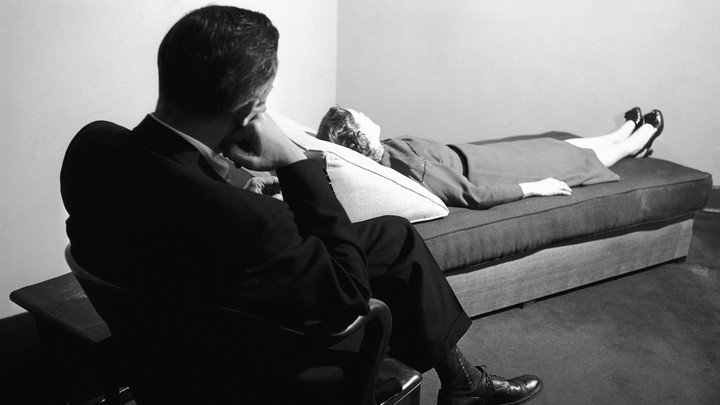 A doctor listens to a patient at the New York Psychoanalytic Institute Treatment Center in New York in 1956.