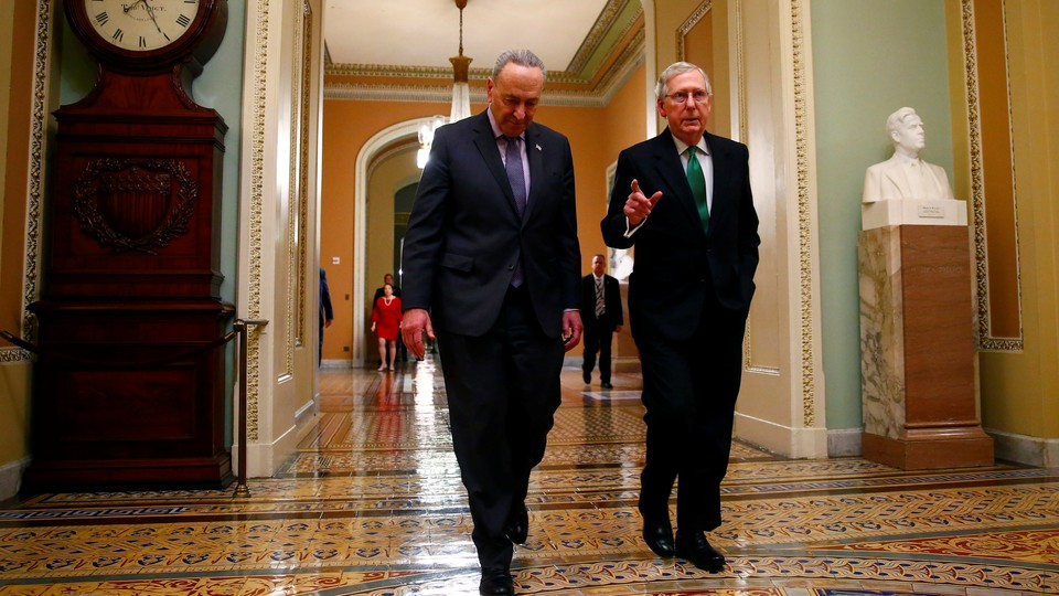 Senate Minority Leader Chuck Schumer and Senate Majority Leader Mitch McConnell walk to the chamber after collaborating on a budget agreement last week.