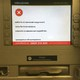 """A virus-infected screen at Ukraine's OshchadBank that says """"sorry for the inconvenience/under repair"""" in Kievon June 28, 2017."""