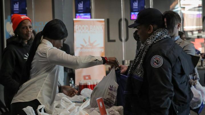 TSA workers line up at a food bank.