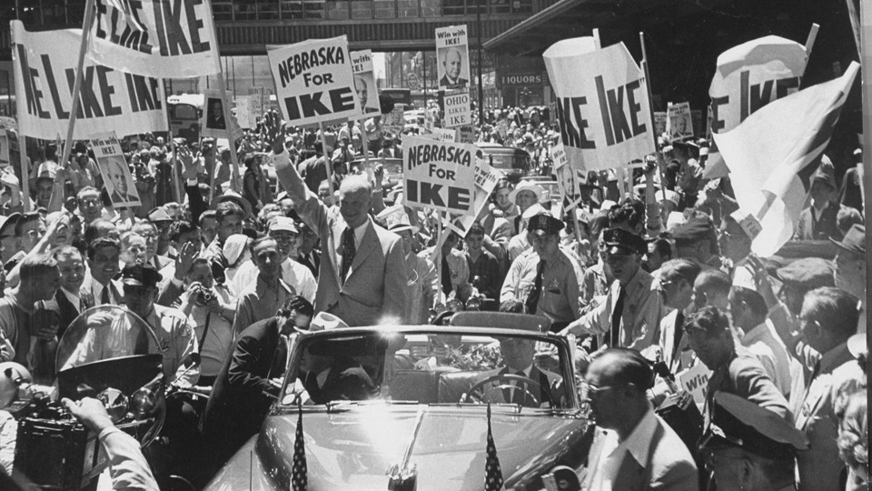 President Eisenhower driving through a crowd of supporters in 1952.