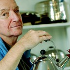 Michael Graves with his Alessi teakettle