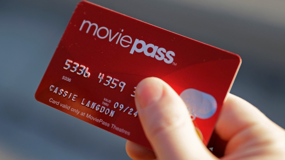 A hand holding a MoviePass card