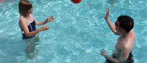 Two residents of a Phoenix apartment building designed for people with autism hang out in the building's pool.