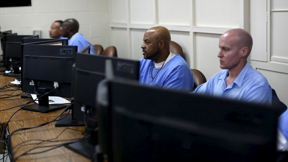 Inmates at work on computers at San Quentin