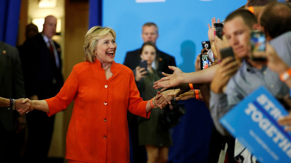 Clinton greets supporters at a rally.