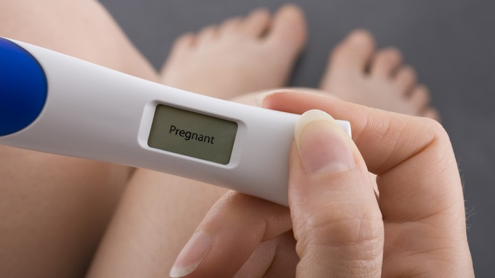 pregnancy test in hand