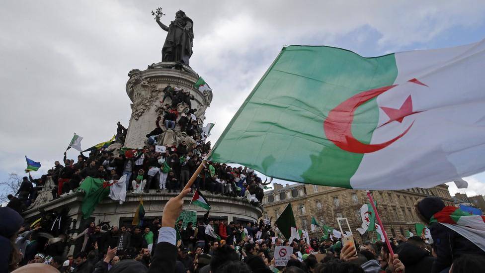 Hundreds of thousands of people protest in Paris against Algerian President Abdelaziz Bouteflika.