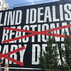 """Barbara Kruger's 2016 mural """"Untitled (Blind Idealism Is...),"""" as seen from the High Line."""