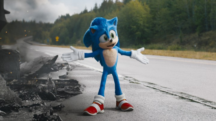Sonic the Hedgehog standing on a torn-up stretch of road.