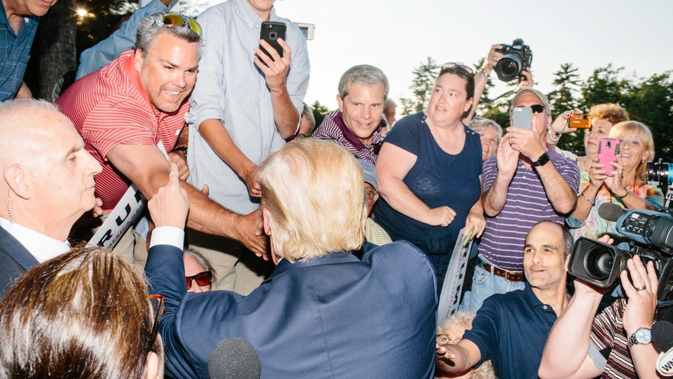 Real-estate mogul and Republican presidential candidate Donald Trump greets supporters after speaking at a rally at the Weirs Beach Community Center in Laconia, New Hampshire.