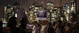 People marching across the Brooklyn Bridge in support of immigrants. New York City, New York, 2017.