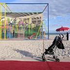 "Visitors explore ""America's Playground,"" an interactive installation by Derrick Adams, in Miami Beach in December 2018."