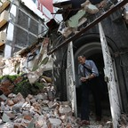 A man walks out of the door frame of a building that collapsed after an earthquake, in the Condesa neighborhood of Mexico City, Tuesday, September 19, 2017.