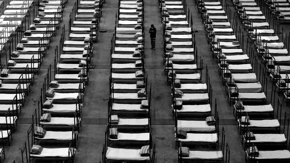 Cots lined up in a room