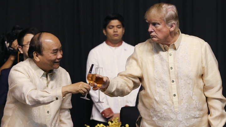 Vietnam's prime minister, Nguyen Xuan Phuc, and Donald Trump raise a glass at the Association of Southeast Asian Nations meeting in Manila in November 2017.